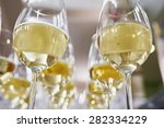 Glasses With Champagne On Whit...