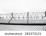 Wired Fence With Barbed Wires...