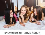 three pretty   young friends... | Shutterstock . vector #282376874