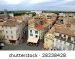 Bird view of the city of Arles in France. No number plates, no brand names and no people - stock photo