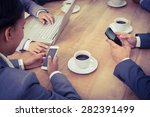 Business People In Meeting Wit...