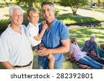 happy family smiling at the... | Shutterstock . vector #282392801