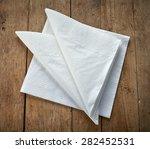 white paper napkins on wooden... | Shutterstock . vector #282452531
