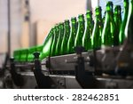 many bottles on conveyor belt... | Shutterstock . vector #282462851