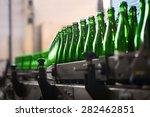 many bottles on conveyor belt... | Shutterstock . vector #282462851