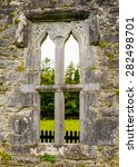 Small photo of Stone arches, columns and plinths form a medieval window at Aughnanure Castle in Co. Galway. The opening provided a view onto adjoining farm land and features some ancient stone carvings.