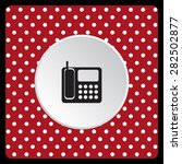 white polka dots on a red phone.... | Shutterstock .eps vector #282502877