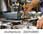 barista using a tamper to press ... | Shutterstock . vector #282510005