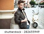 handsome gentleman leaning on... | Shutterstock . vector #282655949
