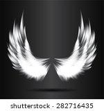 white glowing  stylized angel... | Shutterstock .eps vector #282716435