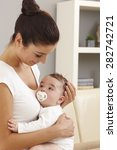 mother and baby boy embracing ... | Shutterstock . vector #282742721