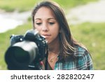 Young Female Photographer And...