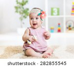 Cute Baby Girl Playing With To...