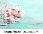 Stock photo cute toddler shoes on wooden background 282903674