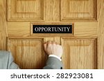 businessman knocking on a door... | Shutterstock . vector #282923081