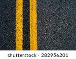 double yellow line on black... | Shutterstock . vector #282956201