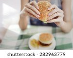 woman holding hamburger and... | Shutterstock . vector #282963779