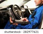 man examining car. confident... | Shutterstock . vector #282977621