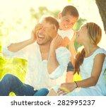happy joyful young family... | Shutterstock . vector #282995237