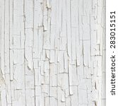 Small photo of Texture of disintegration white paint on wood