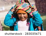 aymara girl playing with... | Shutterstock . vector #283035671