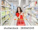 woman whit shopping list at the ... | Shutterstock . vector #283065245