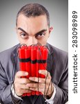 Small photo of Businessman with dynamite isolated on white