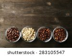 coffee beans in saucers on... | Shutterstock . vector #283105547
