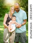 Happy Interracial Family Is...