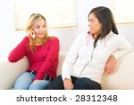 two girls sitting on couch. one ... | Shutterstock . vector #28312348