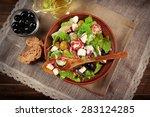 Bowl Of Greek Salad Served On...