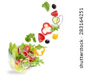 fresh salad with flying... | Shutterstock . vector #283164251