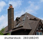 roofer at work repairing a... | Shutterstock . vector #283188245