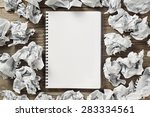 white note pad on a wooden...   Shutterstock . vector #283334561