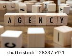 Small photo of agency word written on wood block