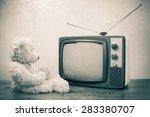 teddy bear toy near retro tv.... | Shutterstock . vector #283380707