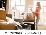 woman removing lamp from moving ...   Shutterstock . vector #283465211