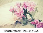 pink roses in vase on wooden... | Shutterstock . vector #283515065