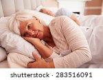 worried senior woman lying... | Shutterstock . vector #283516091