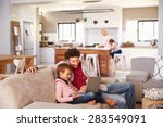 father using computer with son  ... | Shutterstock . vector #283549091