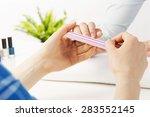 woman in nail salon receiving