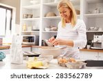 woman baking at home | Shutterstock . vector #283562789