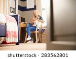 girl sitting at a desk in her... | Shutterstock . vector #283562801