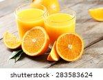orange juice on table close up | Shutterstock . vector #283583624