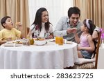 Family Having Fun While Eating...