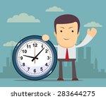 businessman holding a clock... | Shutterstock .eps vector #283644275