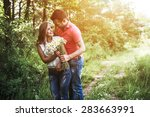 cute couple in a forest | Shutterstock . vector #283663991