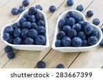 fresh blueberries in two heart... | Shutterstock . vector #283667399