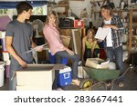 teenage family clearing garage... | Shutterstock . vector #283667441