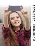 Cute Smiling Girl Making Selfie